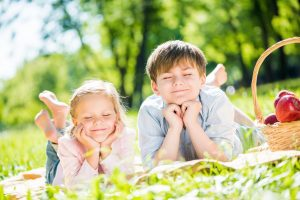kids in the grass with eyes closed