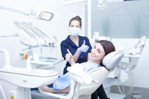 dentist and patient giving a thumbs up